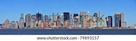 Skyscrapers of New York City Manhattan downtown with urban city skyline panorama over Hudson River with blue clear sky
