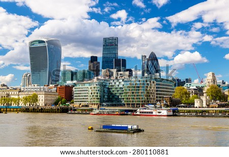 Skyscrapers of the City of London over the Thames - England - stock photo
