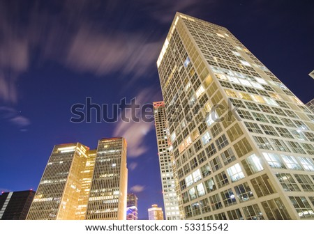 Skyscrapers - office buildings in downtown Beijing at night - stock photo