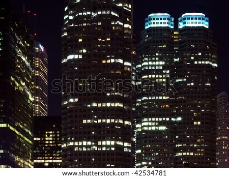 Skyscrapers - office buildings in downtown toronto at night time - stock photo