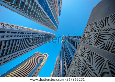 Skyscrapers on a background of blue sky. View from the bottom up - stock photo