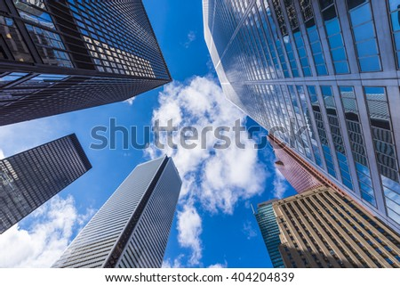 Skyscrapers reach for the blue sky in downtown Toronto Canada.