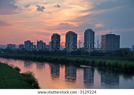 Skyscrapers reflection in river at sunset in Zagreb, Croatia - stock photo