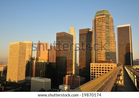 Skyscrapers tower over a rooftop walkway in downtown Los Angeles - stock photo