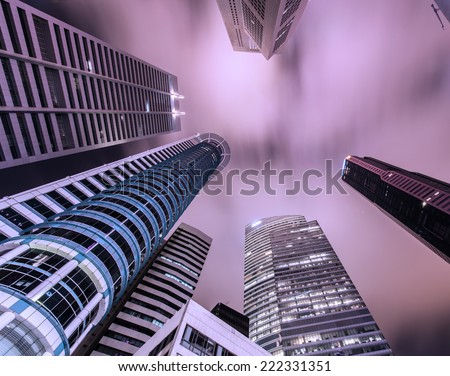 Skysrapers in Singapore during night hours - stock photo