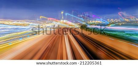 Skytrain moving fast at night - stock photo