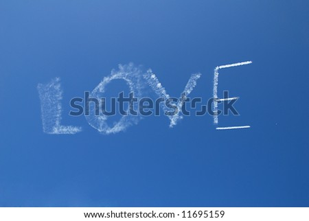 Skywriting the word Love on a clear day - stock photo