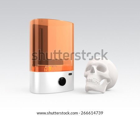 SLA  3D printer and plastic skull model isolated on gray background. Clipping path available. - stock photo