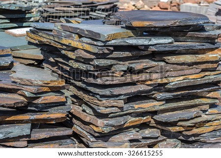 Slabs of slate ready to be purchased for construction projects such as walkways. - stock photo