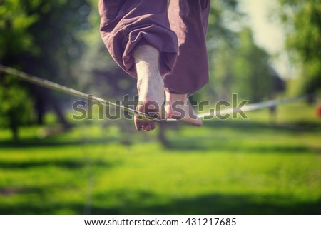 Slacklining is a practice in balance - stock photo