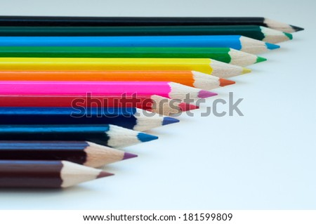 Slanting colorful wooden crayons, closeup of tips of pencils macro with shallow dof.  - stock photo