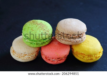 Slate background. pile of fresh and delicious macaroon