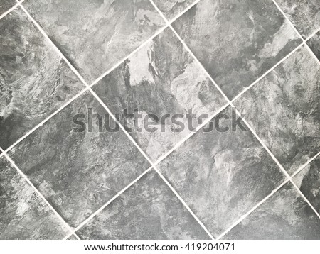 Slate effect square vinyl tiles as a background