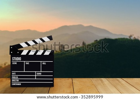 Slate film, Film clapper or Movie director slate on wood table or wood floor. with Blur  mountain background. for production of film Concept - stock photo