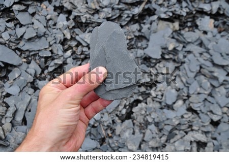 Slate, raw shale, geologic material - stock photo