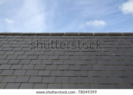 Slate roof against blue sky on the island of Jersey - stock photo