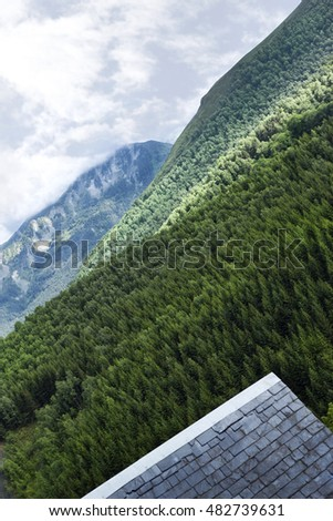 Slate roof and mountains in French Pyrenees