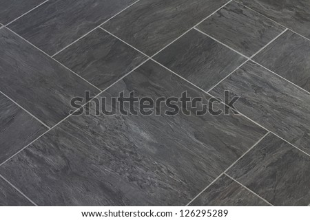 Slate texture vinyl flooring a popular choice for modern kitchens and bathrooms - stock photo