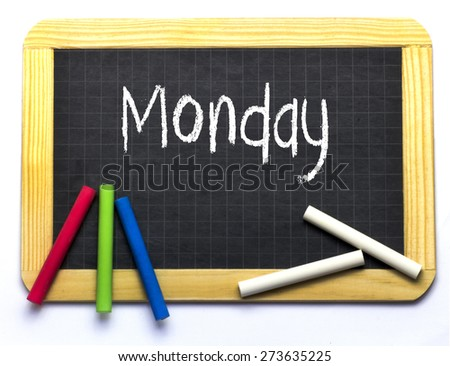 Slate with coloured and white chalk - Monday - stock photo