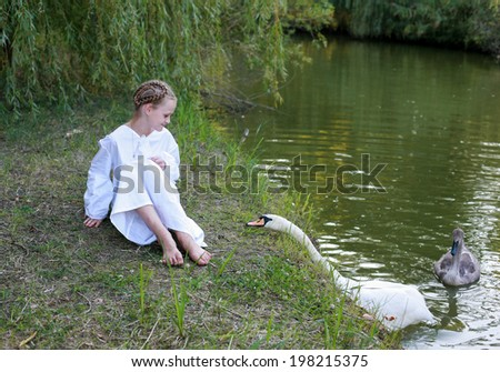 Slav girl in a white shirt on a pond. Swan, pulling her neck/On a pond