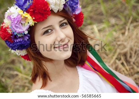 Slav girl with wreath at field