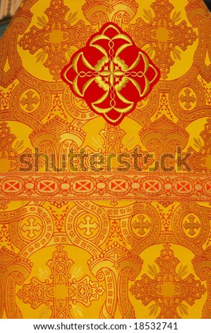 Slavic orthodox priest's yellow mantle background - stock photo