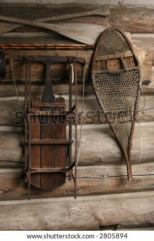 SLED AND SNOW SHOE WAITING FOR USE - stock photo