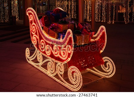 Sledge of Santa Claus with gifts - stock photo