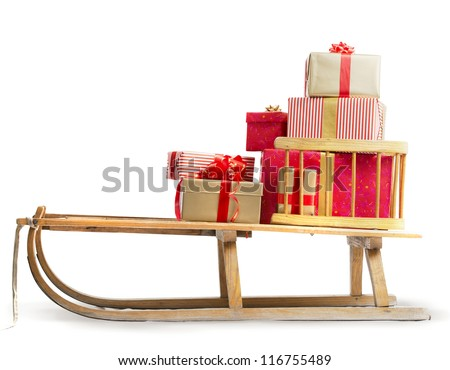 Sledge with Christmas presents - stock photo