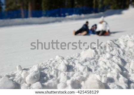 Sledging in the snow play ground, Lake Tahoe. - stock photo