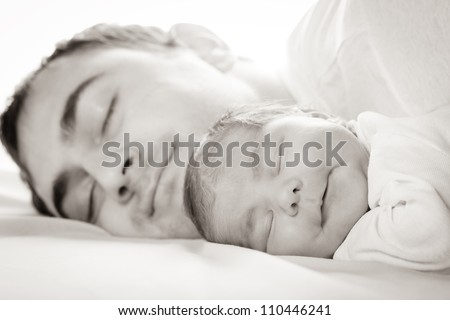 Sleep baby with dad, closeup faces - stock photo