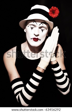 sleep mime in white hat with red flower on a black background - stock photo