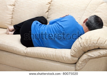 sleeper on the couch - stock photo