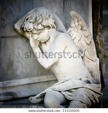 Sleeping Angel at La Recoleta Cemetery in Buenos Aires - stock photo