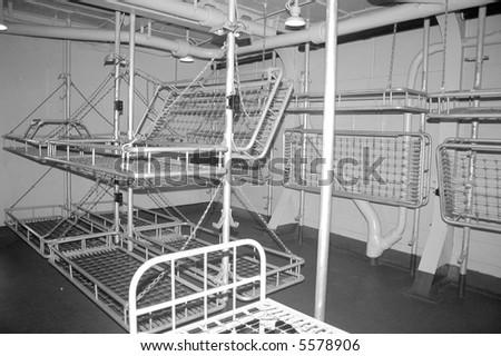 Sleeping area aboard a WWII battleship. - stock photo