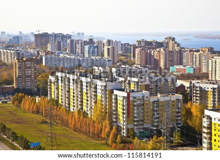 Sleeping area of social housing in the city of Samara. Against the background of the Volga and the houses under construction in the city center. The urban landscape.