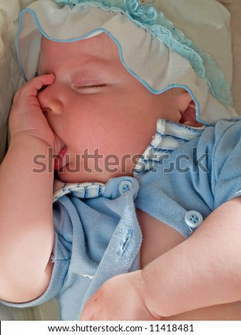 sleeping baby and suck his finger - stock photo