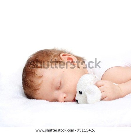Sleeping Baby Boy with toy on a White Blanket - stock photo