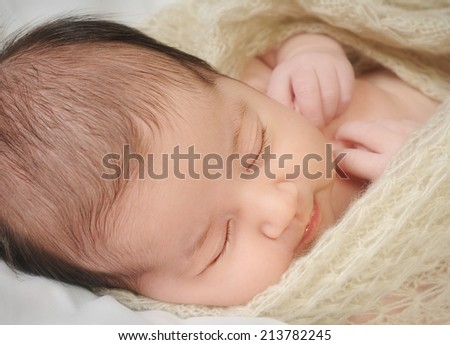 Sleeping baby closeup portrait shallow dof