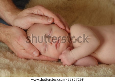 Sleeping Baby in Fathers Hands - stock photo