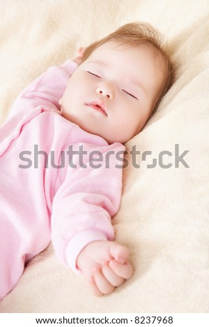 Sleeping baby in pink clothes - stock photo