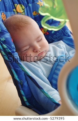 Sleeping Baby In Swing - stock photo