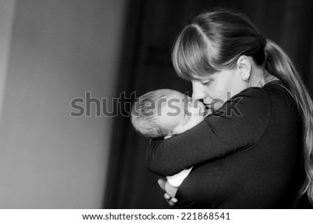 Sleeping baby on the mother's hands - stock photo