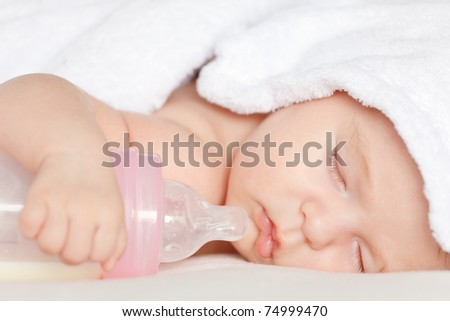 Sleeping baby with bottle