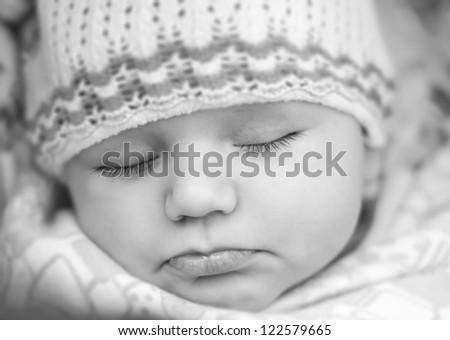 Sleeping beautiful baby, horizontal portrait a closeup  Black and White photo - stock photo