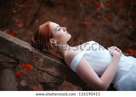sleeping beauty bride on stairs - stock photo