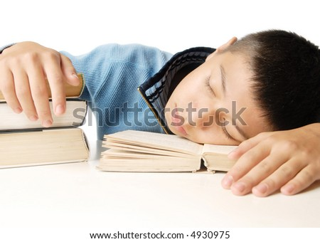 Sleeping boy and educational books on a white background - stock photo