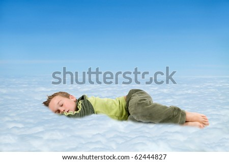 Sleeping boy in the clouds, dreaming about something nice. - stock photo