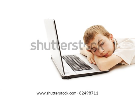 Sleeping boy with a laptop on a white background - stock photo