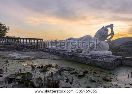 Sleeping Buddha and belfry on sunset at Hua-Hin,Thailand - stock photo